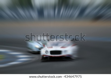 car racing on the road and  track with motion blur and Radial blur  - stock photo