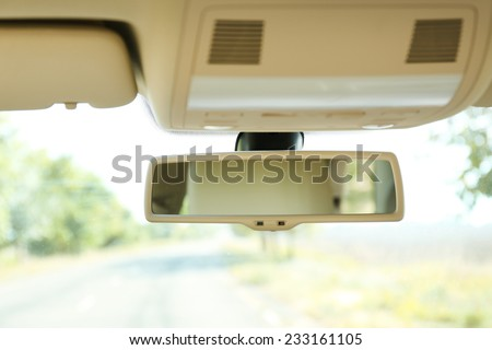 Car rear view mirror, close up - stock photo