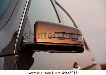 Car rear view mirror closeup - stock photo