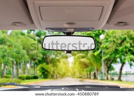 Car rear view mirror inside the car. - stock photo