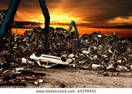 Car recycling to the dump.Dramatically scene at the sunset. - stock photo