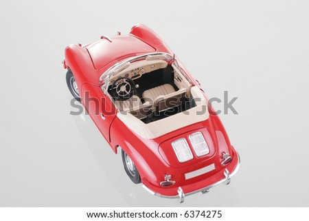Car red with reflection. The photo studio.