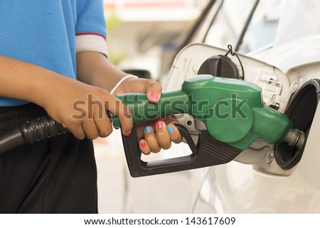 Car refuel in gas station - stock photo