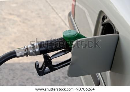 car refueling gasoline in gas-station Bangkok, Thailand - stock photo