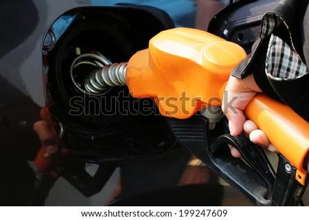 Car refueling nozzle - stock photo
