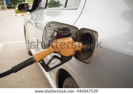 Car refueling on a gas station. - stock photo