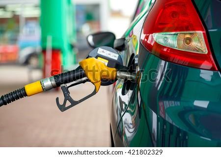 Car refueling on a petrol station closeup - stock photo