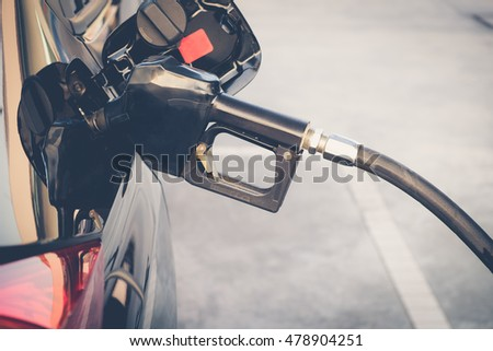 Car refueling on petrol station. To fill the machine with fuel. Car refueling with gasoline at gas station. Fuel pump at station.