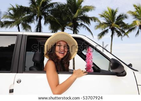 car rental: happy woman in her new car near the beach - stock photo