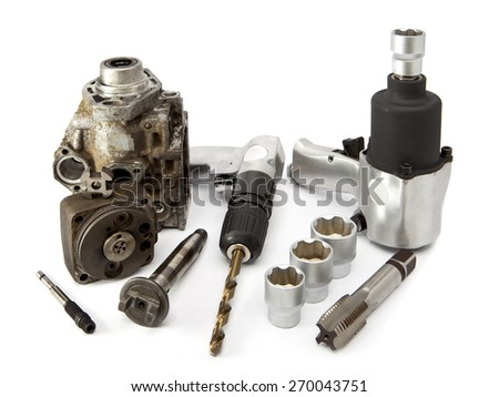 Car repair - details of the pump of high pressure and air impact wrench on white background - stock photo