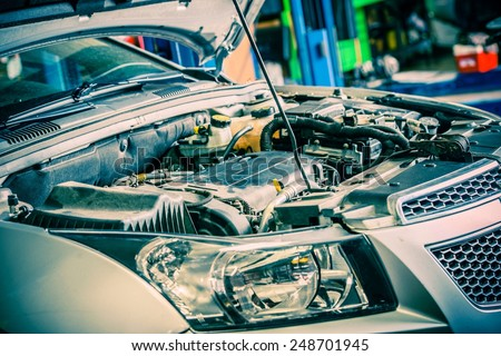 Car Repairing. Modern Compact Car with Open Hood. Car Under Maintenance. - stock photo