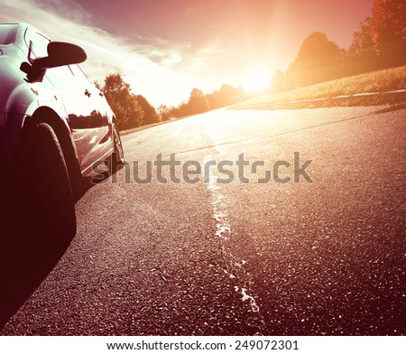 Car ride on road in sunny weather, motion blur - stock photo