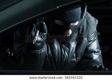 Car robber at night
