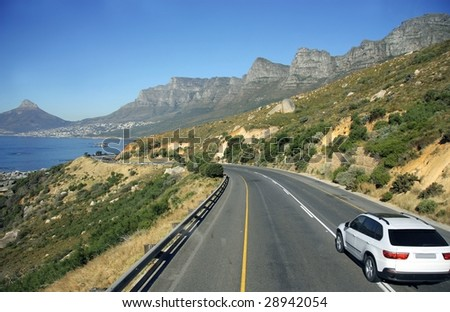 car running on a panoramic road - stock photo