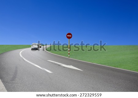 Car running on the grass land road,China - stock photo