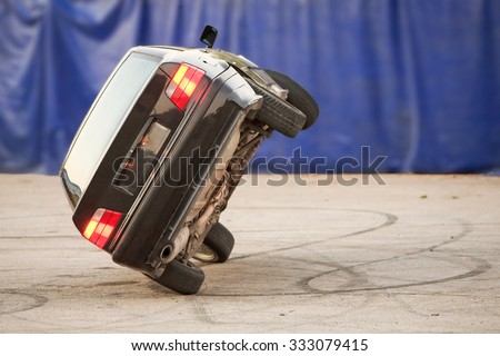Car Running On Two Wheels Suggesting Danger Stunt Demo - stock photo