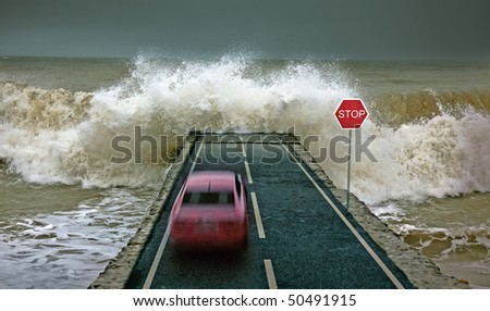 car rushing along the highway towards the giant wave - stock photo