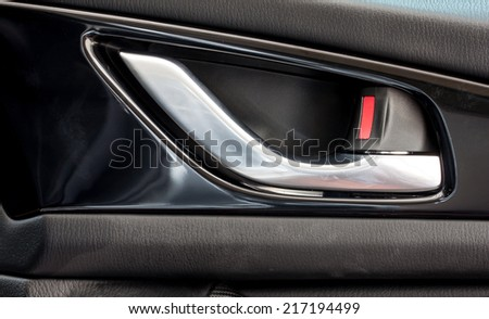 car's door opening handle - stock photo