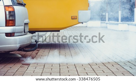 Car's fumes emissions - stock photo