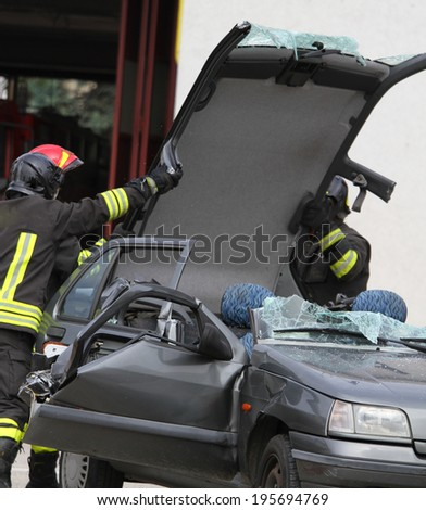 car's hood is removed after the accident to rescue the injured persons - stock photo