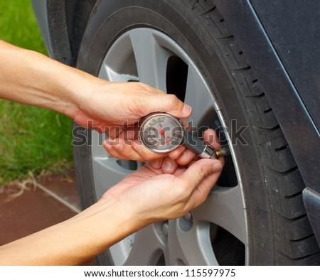 car's tyre pressure measurement - stock photo