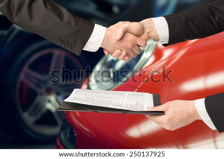car salesperson and agreement - stock photo