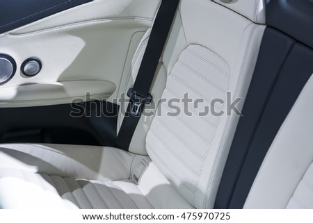 Car seat from light skin.Small depth of field. Stock photo