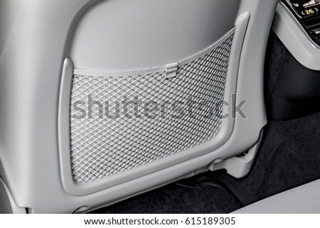 Car seat net for holding documents