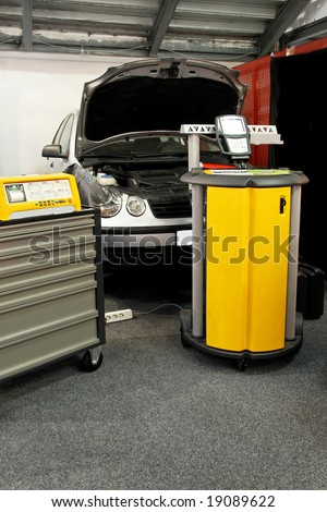 Car service garage with diagnose test equipment - stock photo