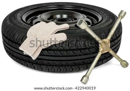 Car service. Tyre with screwdriver and white glove. Isolated - stock photo