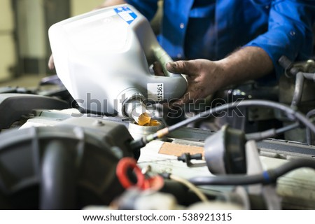 car servicing oil and filter replacing maintenance