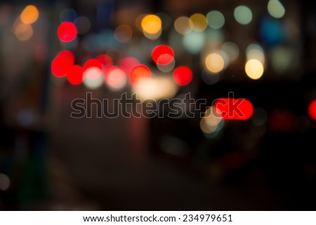 car sparkle light on road when christmas day (Blurred Style) with Bokeh - stock photo
