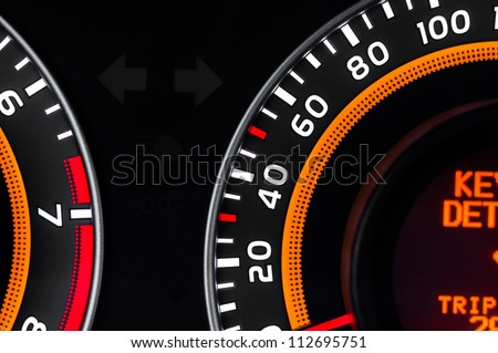 Car speed meter closeup in vibrant colors