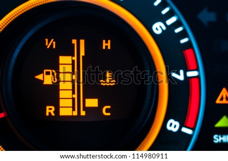 Car speed meter closeup in vibrant colors - stock photo