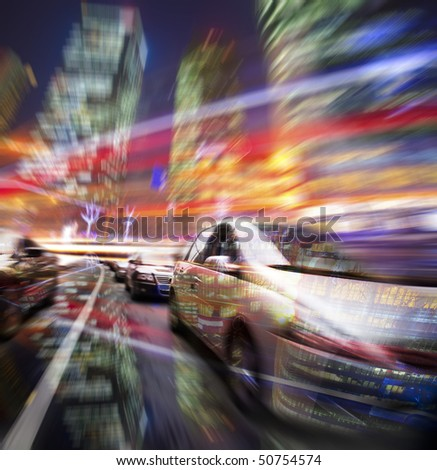 car speeding on the street wiht motion blur building background in night. - stock photo