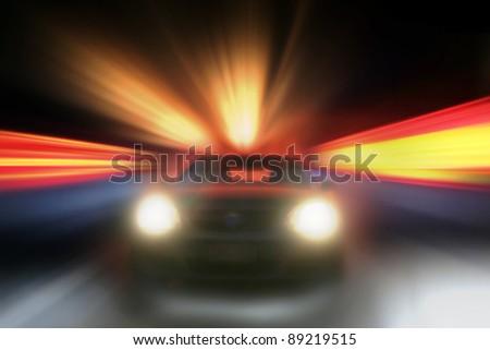 Car speeding towards camera, bright background - stock photo