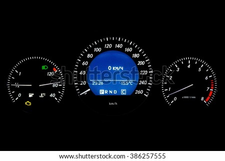 Car speedometer isolated on the black background with check engine light on - stock photo