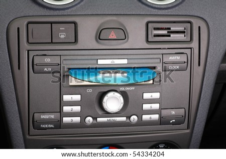 Car stereo CD and FM radio. - stock photo