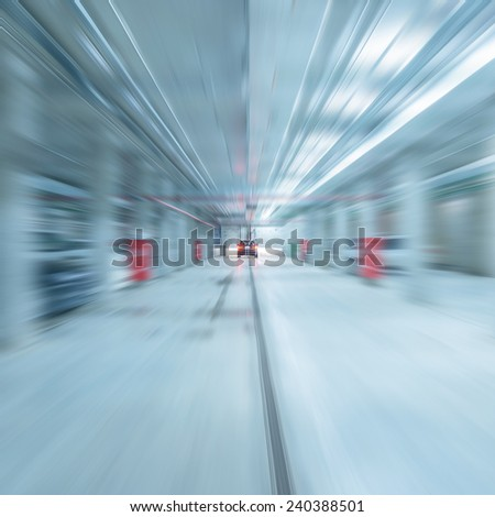 Car stops by the wall after high speed motion in the underground parking.  - stock photo