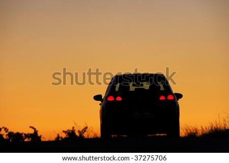car sunset - stock photo