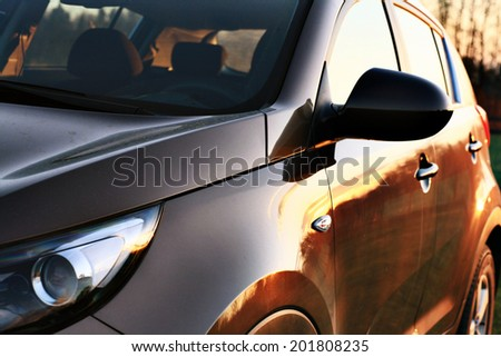 car sunset reflection - stock photo