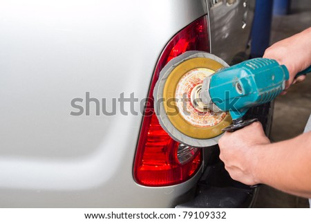 Car tail light with power buffer machine at service station - a series of CAR CARE images. closeup Useful as background for design-works. - stock photo
