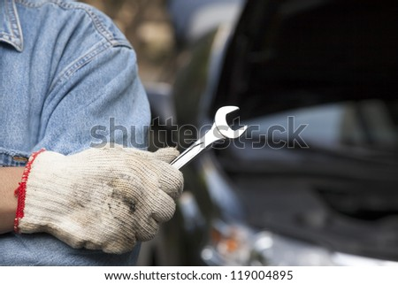 car technician holding the wrench - stock photo