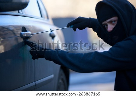 car thief . Focused on screwdriver - stock photo