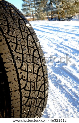 Car tire in the winter way - stock photo