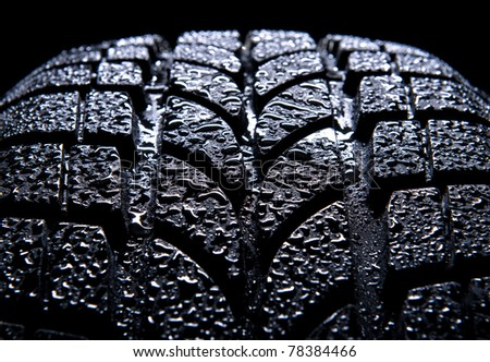 Car tire isolated on black background - stock photo