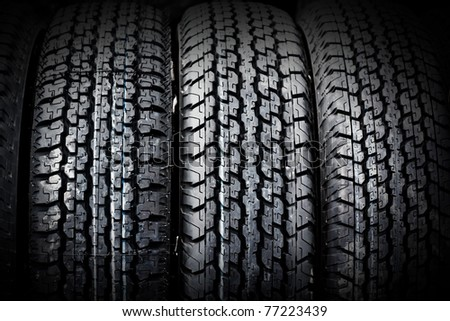 car tire on black background. Useful as background for design-works.