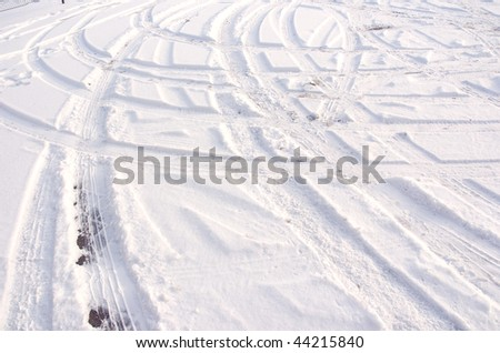 Car tire track in fresh light snow - stock photo