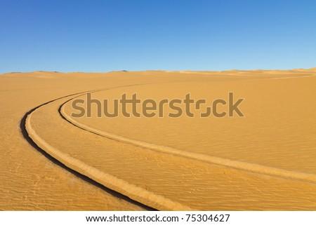 Car tire tracks in the desert - Awbari Sand Sea, Sahara, Libya - stock photo