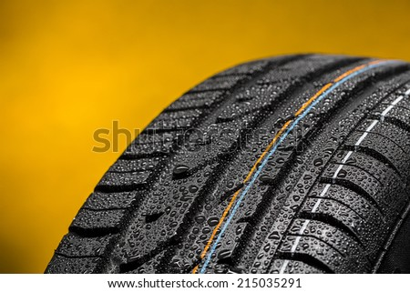 Car tire with raindrops summer tire aquaplaning - stock photo
